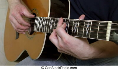 instrument with guitarist hands
