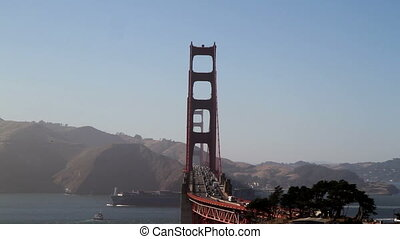 Golden Gate Bridge cargo ship passing through