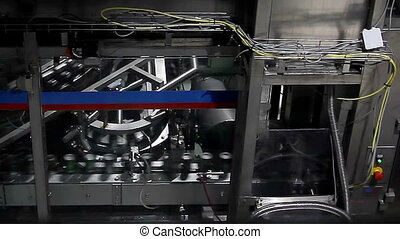 Metal beer banks on conveyor. - Moscow, Russian Federation -...
