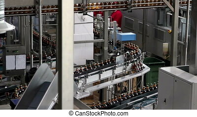 Plastic water bottles on conveyor