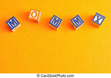 Mommy - The word mommy spelled with alphabet blocks against...