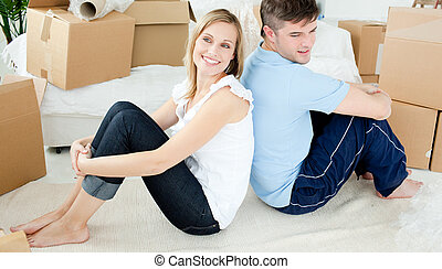 Young couple painting a room in the