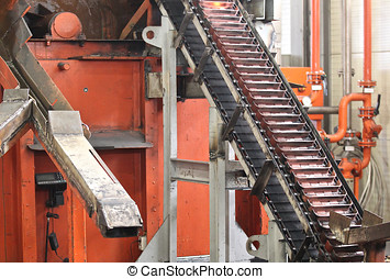 elevator for lifting hot grinding balls after rolling mil