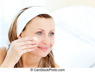 Cheerful woman putting make-up at home - Portrait of a...