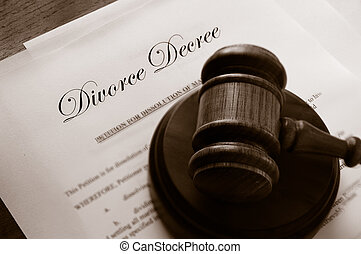 Legal gavel on top of divorce papers