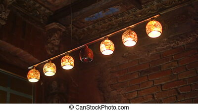 six chandelier lights one does not shine