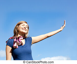 Jolly  blond woman against blue sky