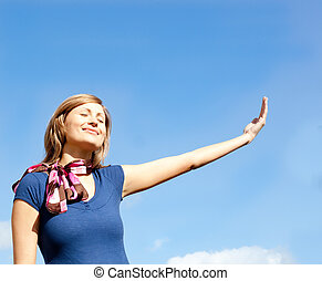 Cheerful  blond woman against blue sky