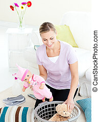 Smiling woman doing housework