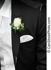 Groom with flower on lapel - Partial view - Groom with...