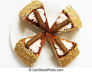 Sponge cake with cream and chocolate on white background