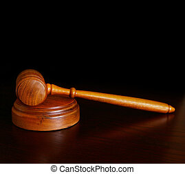 court gavel on desk, over dark background