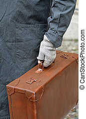 poor emigrated with leather suitcase and the glove during...