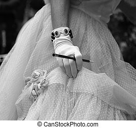gloved hand on the elegant lady with the cigarette holder -...