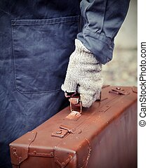 poor emigrated with old leather suitcase - emigrated with...