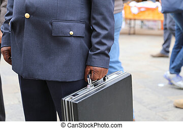 cop with a suitcase with many documents - cop with a...