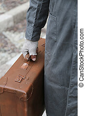 poor man with old leather suitcase and broken gloves - poor...