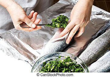 Cooking trout in foil - Fresh trout fish in foil prepared...