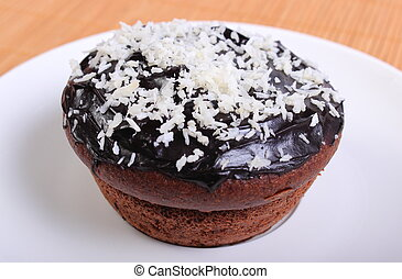 Fresh baked chocolate muffins with desiccated coconut -...
