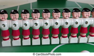 toy football players stand in a row ,