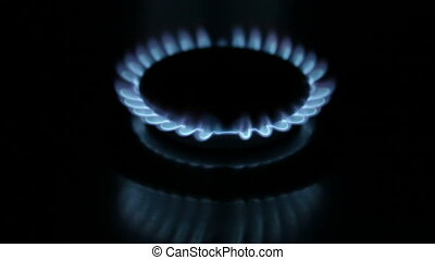The burning torch on the gas stove ,