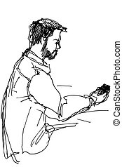 young man with a beard looking at phone