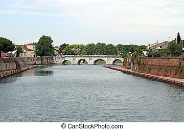 old stone Tiberius bridge Rimini Italy