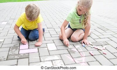 kids painting with chalk outside