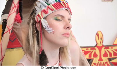 Girl with headband and make-up touching her face - close-up...