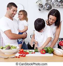 United family cooking together in the kitchen