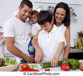Adorable family cooking together in