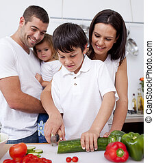 Cute family cooking together in the