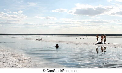 People rest at the exotic salt lake - Nizhniy Baskunchak,...