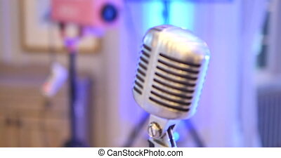 Microphone. Retro microphone. A microphone on stage. A pub -...