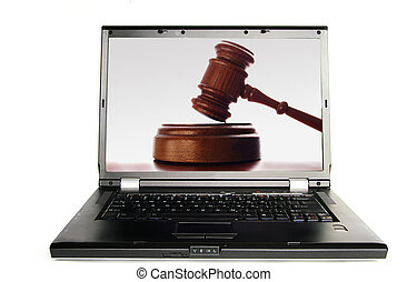 Laptop a judges court gavel on screen, over white