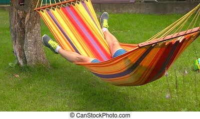 Man swinging in hammock 4K video - Man having rest in bright...