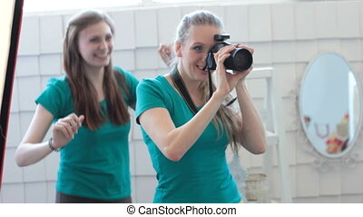 Funny assistant and photographer making faces - Two cheerful...