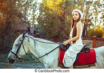 the girl in the hat on the horse - young cowgirl on white...