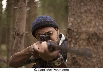 Interracial hunter aiming at prey
