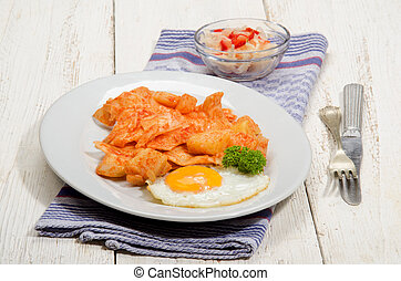 hungarian dish with paprika potatoes, noodles and fried egg