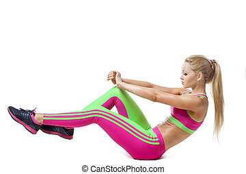 Woman doing strength exercises for abdominal muscles...