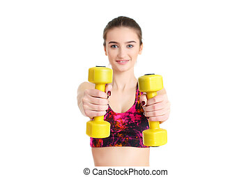 Fitness woman exercising crossfit holding dumbbell strength train