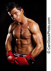 muscular man fighting box over dark background