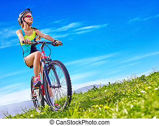 Bikes cycling girl wearing helmet rides bicycle. - Bicycle...