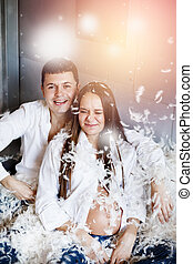 Young couple having pillow fight - Pillow fight Young happy...