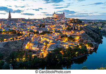 Toledo at dusk Spain - Toledo Cityscape with Alcazar at dusk...