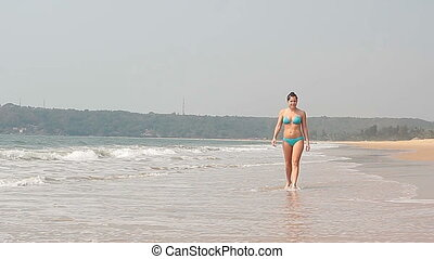 woman relaxing on the Goa beach