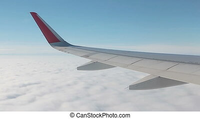 View on the Wing of airplane from window