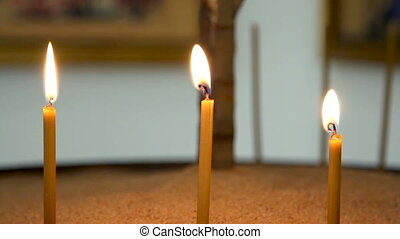 candles cutting through the darknes - view of the view of...