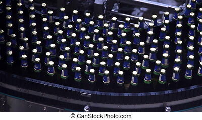 Beer bottles on conveyor